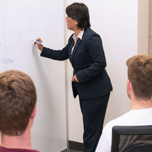 Dr. Esther instructing in a classroom